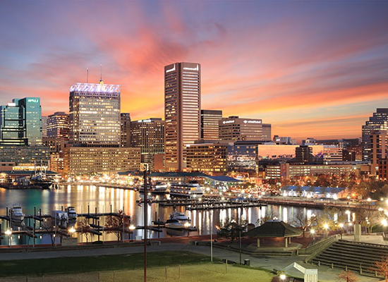 Photo of sunset over downtown Baltimore and the Inner Harbor