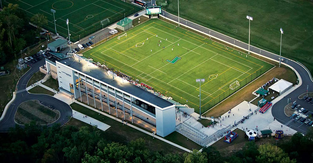 An aerial shot of the Ridley Athletic Complex, with players on the field and a full crowd
