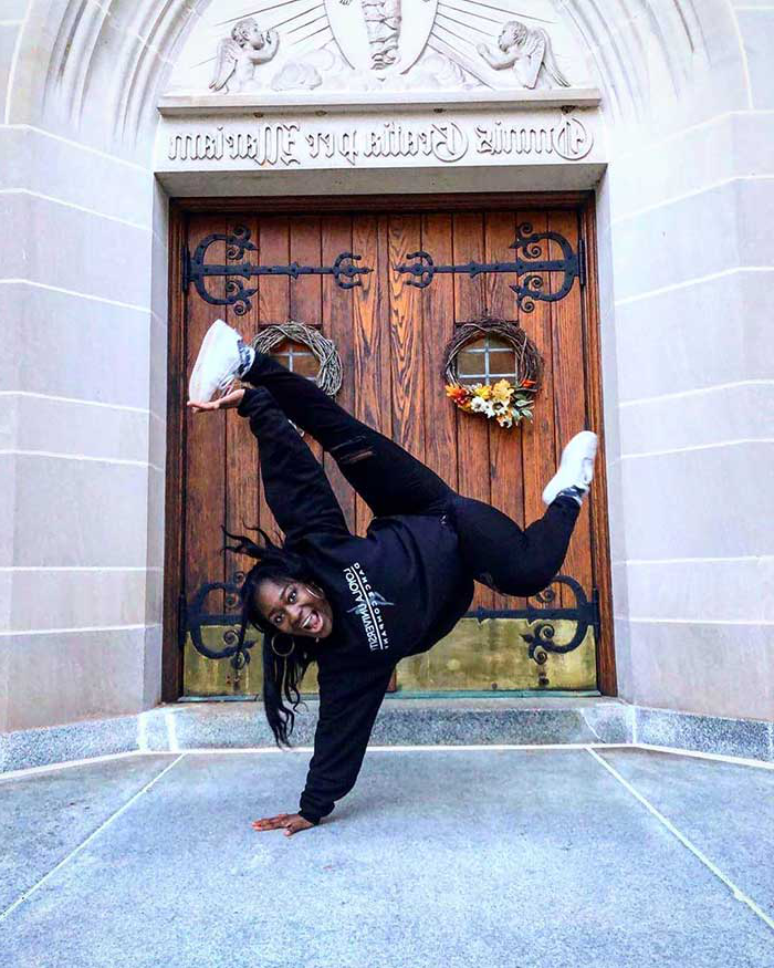 A Loyola dancer striking a one-handed pose