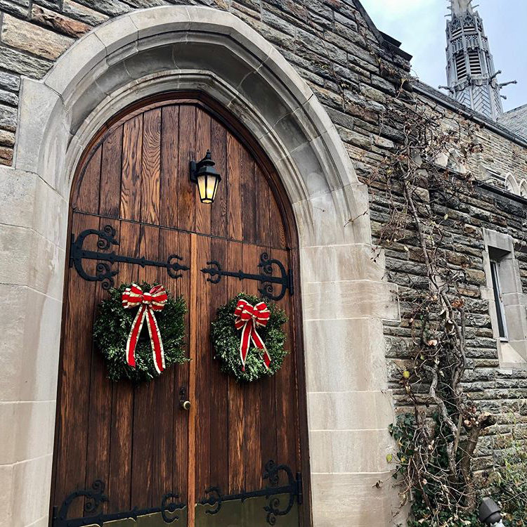 Christmas wreaths on wooden chapel doors