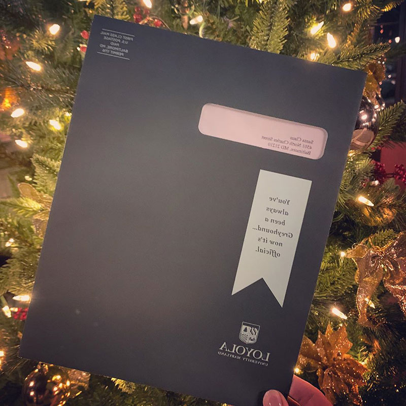 Loyola admission acceptance envelope addressed to Santa Claus, in front of a Christmas tree