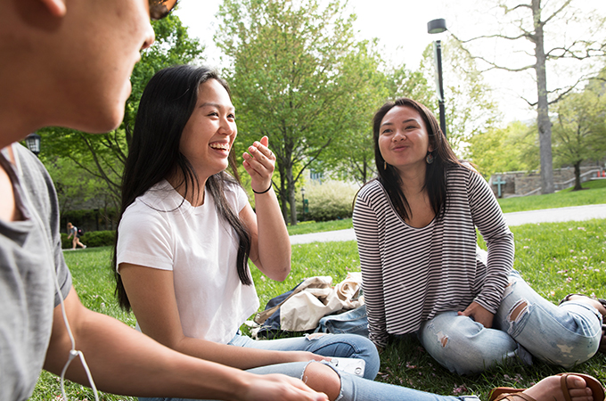 A group of students enjoy a spring day on the quad.
